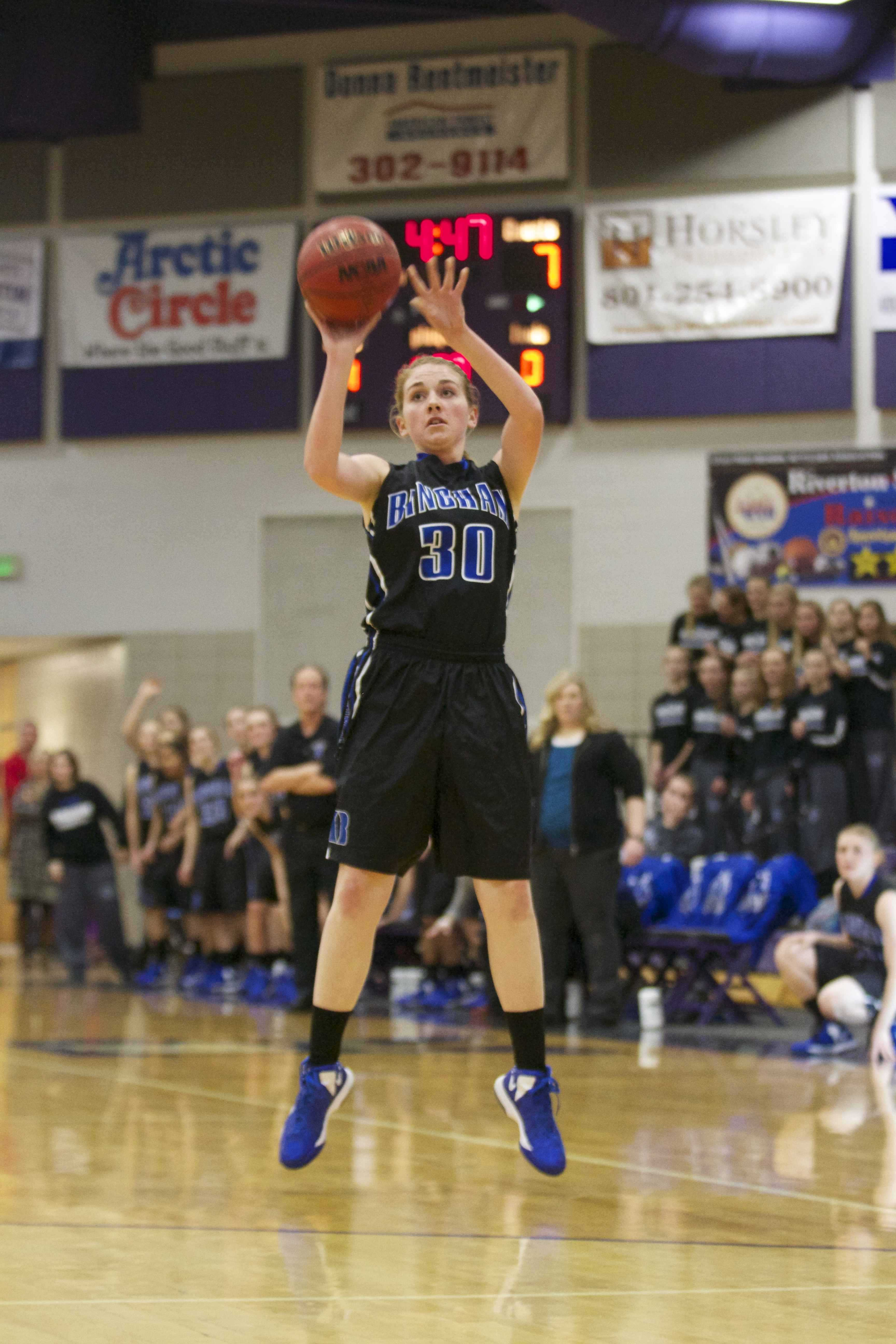 Powell attempts a three during a game with Riverton.