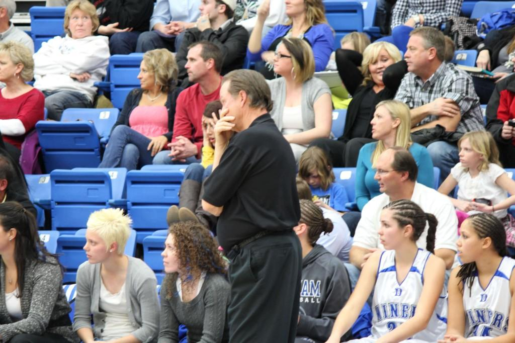 Rand Rasmussen watches his Lady Miners as they play the Syracuse Titans in the quarterfinals of the state tournament.