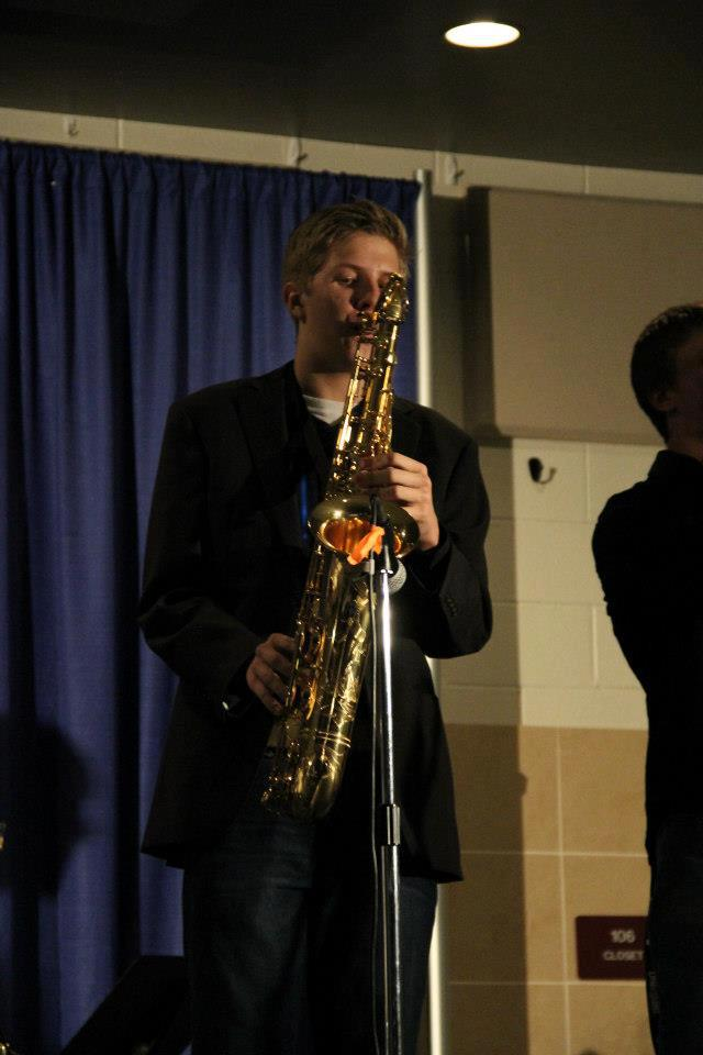 Alex+Thomson+plays+his+saxophone+at+a+benefit+concert+in+December
