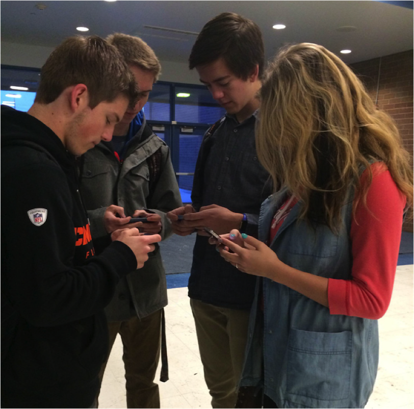 Students at Bingham busy on their phones.