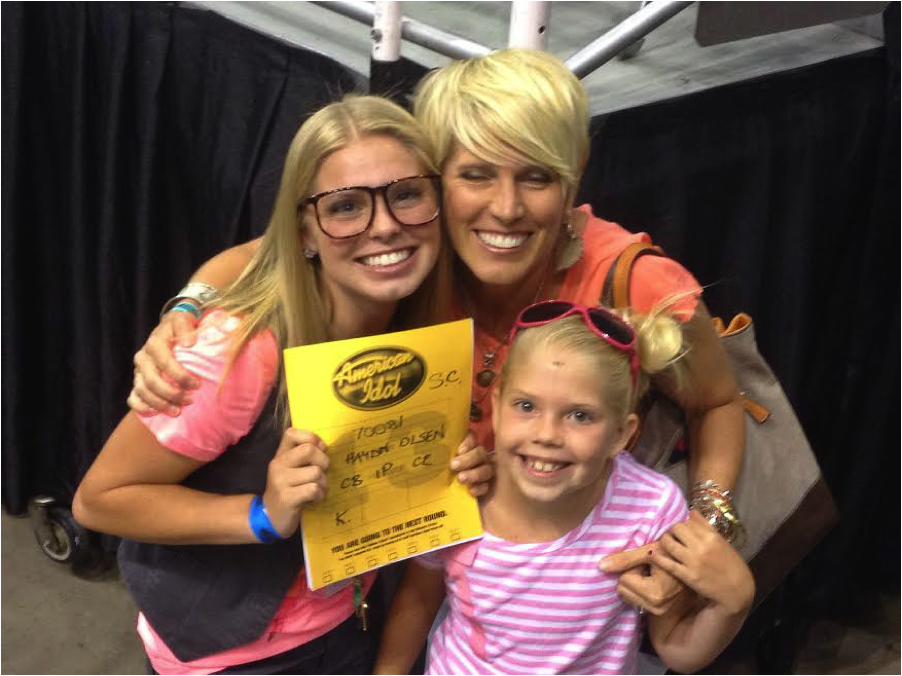 Haydn Olsen holding up her American Idol ticket