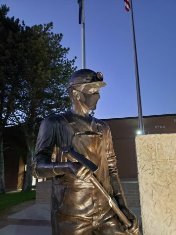 Bingham High School Miner statue wearing his mask