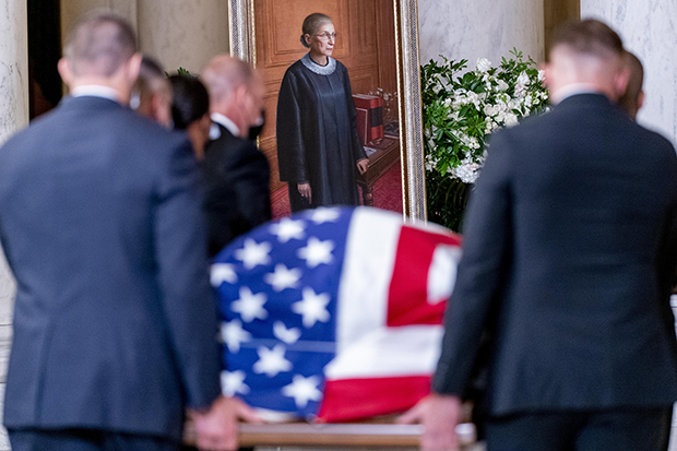 Justice+Ginsburg+is+carried+into+the+Supreme+Court+one+last+time+on+September+23%2C+2020%2C+with+the+American+flag+draped+over+her+casket.
