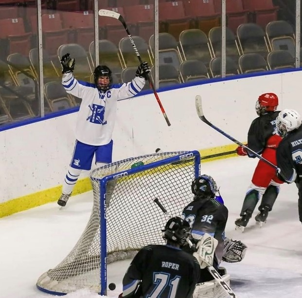 Braxton Porter #18, Bingham Hockey's Captain, celebrates after scoring a goal. Photo Credit: Courtney Ryan