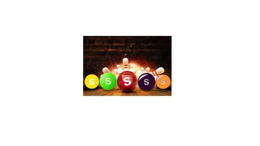 A bowling ball destroying pins with a little help from the skittles.