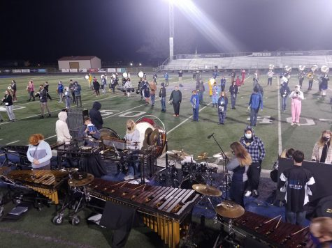 Marching band members participating in their last rehearsal before their show.