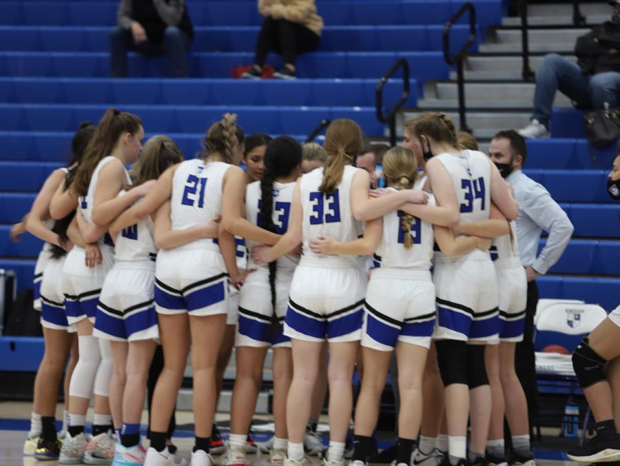 The Bingham Girl's Basketball Team unites in their game against Viewmont High School.
