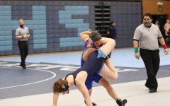 Jordan Wardle taking down a West Jordan wrestler.