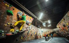 """Skilled climber demonstrates the climbing style: """"bouldering."""""""