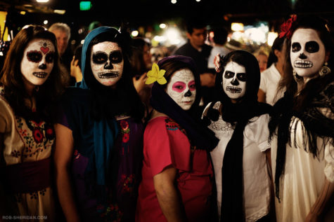 Five women celebrate Dia De Los Muertos
