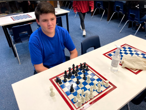 Board Games Club founder Gabe Snowball playing chess